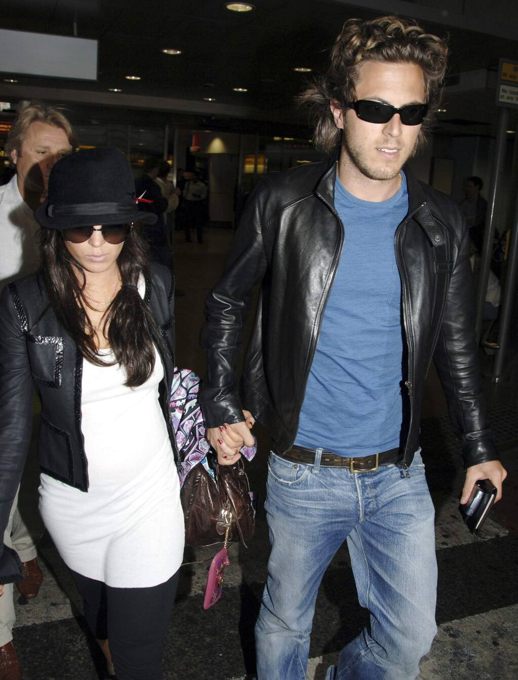 FILE - In this Thursday Sept. 7, 2006, file photo, Hollywood actress Lindsay Lohan, left, and boyfriend, Harry Morton arrive at London's Heathrow Airport from Venice, Italy. Harry Morton, a restaurant mogul who is the son of the Hard Rock Cafe chain co-founder and grandson of the Morton's The Steakhouse founder, has died. Pink Taco, a restaurant business Morton founded and previously owned, confirmed his death in a statement Sunday, Nov. 24, 2019. He was 38. (AP Photo/File)