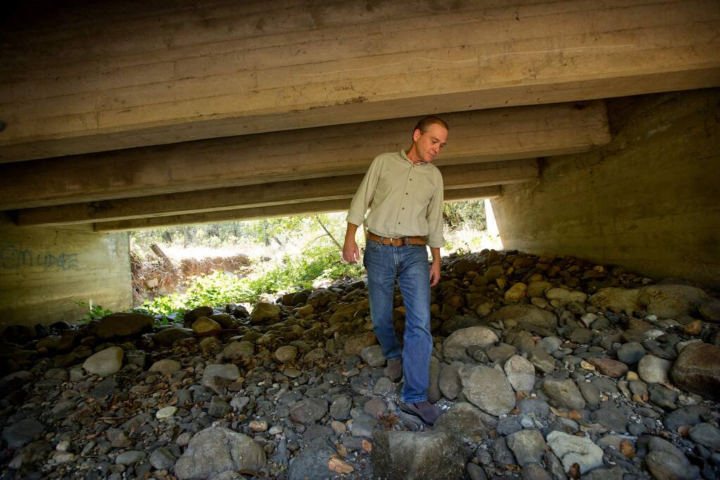 Sonoma Land Trust program manager Tony Nelson walks through a tunnel under Hwy 12 at Glen Oaks Ranch in Glen Ellen used by animals to travel under the busy highway. The Land Trust has received a grant for their work improving the wildlife passage between Napa and Marin. (JOHN BURGESS/The Press Democrat)