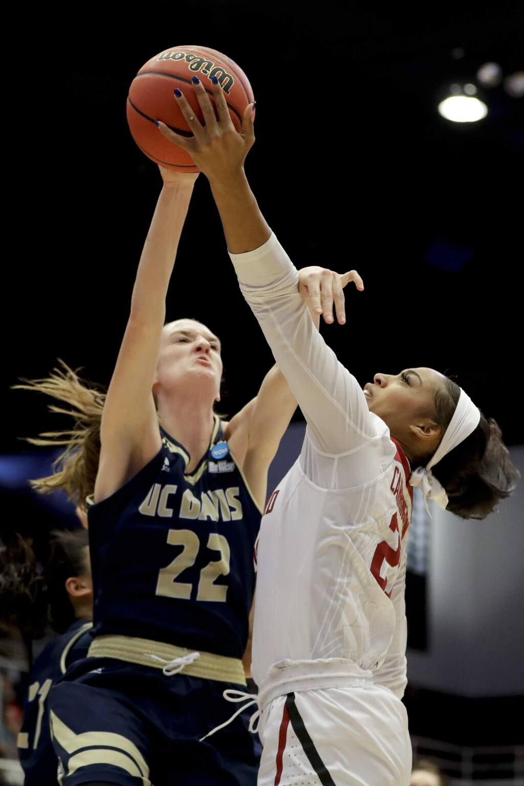 UC Davis forward Morgan Bertsch, let, blocks a shot by Stanford guard Kiana Williams during the first half of a first-round game in the NCAA women's college basketball tournament in Stanford, Calif. Saturday, March 23, 2019. (AP Photo/Chris Carlson)