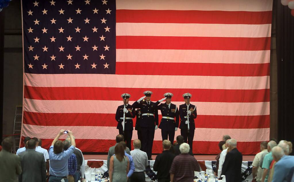 The color guard from the Two Rock Coast Guard base salute the colors during the 17th Annual Tribute to our Veterans luncheon, Thursday, Nov. 9, 2018 at the Santa Rosa Veterans Memorial Building in Santa Rosa. (Kent Porter / The Press Democrat) 2018