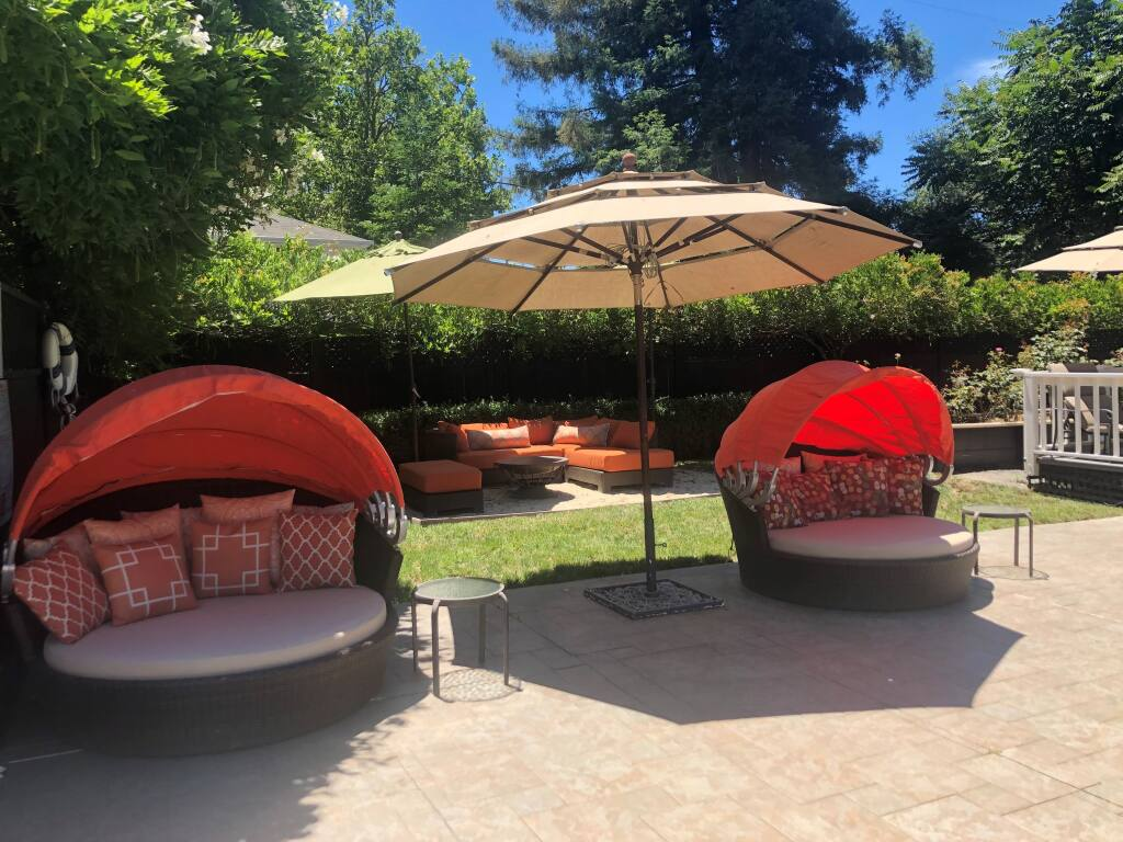 Honor Mansion, a resort in Healdsburg with 13 guest rooms and suites, has reset its outdoor lounge area to comply with social distancing standards. (Carmen Fowler Photography)