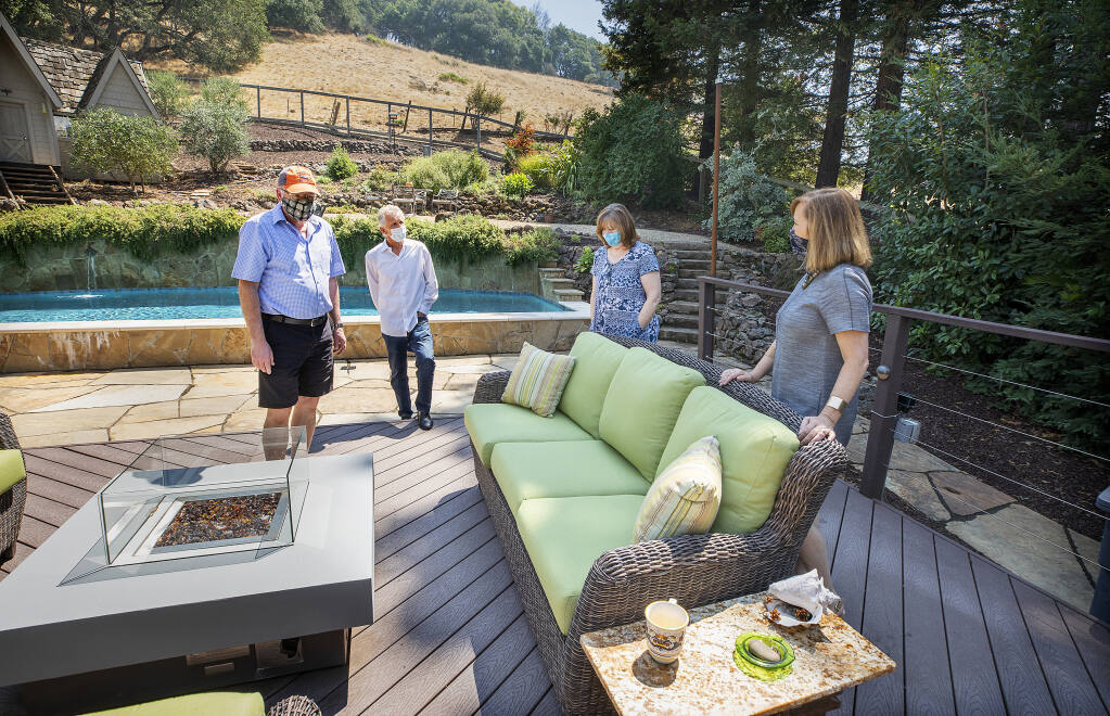 From right, real estate agent Tammra Borrall shows off the backyard of an east Santa Rosa home to Patty and Mark Bowers and their agent, Ed Heinz, on Thursday, Aug. 20, 2020. (John Burgess / The Press Democrat)