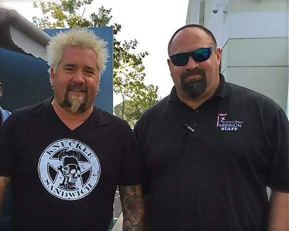 Guy Fieri and Chris Keys, director of shelter and recovery ministries at Redwood Gospel Mission. Fieri's 'Guy's Grocery Games' television cooking show donates thousands of pounds of food weekly to the mission during the four months of recording at the Santa Rosa studio dubbed 'Flavortown Market.' (Redwood Gospel Mission 2015)