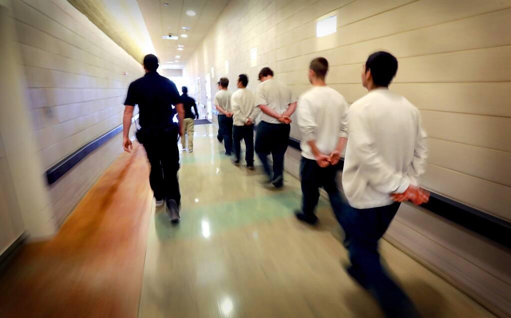 Juvenile Hall guards walk inmates from their unit to a meeting. (JOHN BURGESS / The Press Democrat, 2017)