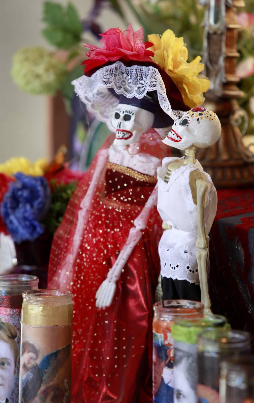 Skeletons decorate an altar during a Dia de los Muertos celebration at Old Courthouse Square in Santa Rosa on Sunday, Nov. 2, 2014. (BETH SCHLANKER/ PD FILE)