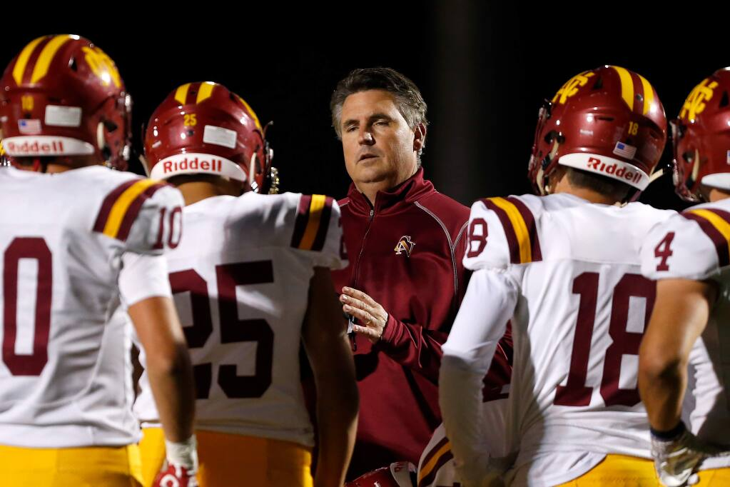 Cardinal Newman head coach Paul Cronin comes out to talk with his defense after they repeatedly made false start penalties during the first half between Cardinal Newman and Rancho Cotate high schools, in Rohnert Park on Friday, Oct. 4, 2019. (Alvin Jornada / The Press Democrat)
