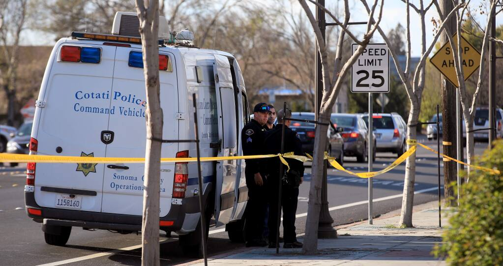 Rohnert Park Department of Public Safety officers gather at the scene of a fatal stabbing in Cotati, Friday, March 20, 2020. (Kent Porter / The Press Democrat) 2020