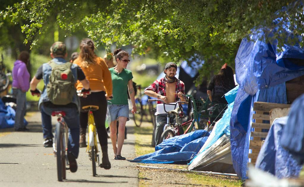 Homeless in a large encampment along the Joe Rodota Trail in Roseland received a 2-day reprieve to evacuate the area by local law enforcement on Friday. (photo by John Burgess/The Press Democrat)