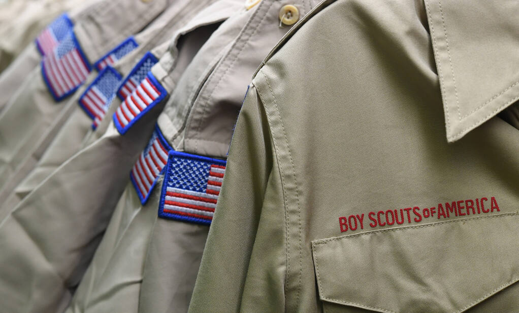 FILE - In this Feb. 18, 2020, file photo, Boy Scouts of America uniforms are displayed in the retail store at the headquarters for the French Creek Council of the Boy Scouts of America in Summit Township, Pa. Close to 90,000 sex-abuse claims have been filed against the Boy Scouts of America as the deadline arrived Monday, Nov. 16 for filing claims in the BSA's bankruptcy case. The number far exceeded initial projections of lawyers across the United States who have been signing up clients in the case since the Boy Scouts filed for bankruptcy protection in February in the face of hundreds of lawsuits. (Christopher Millette/Erie Times-News via AP, File)