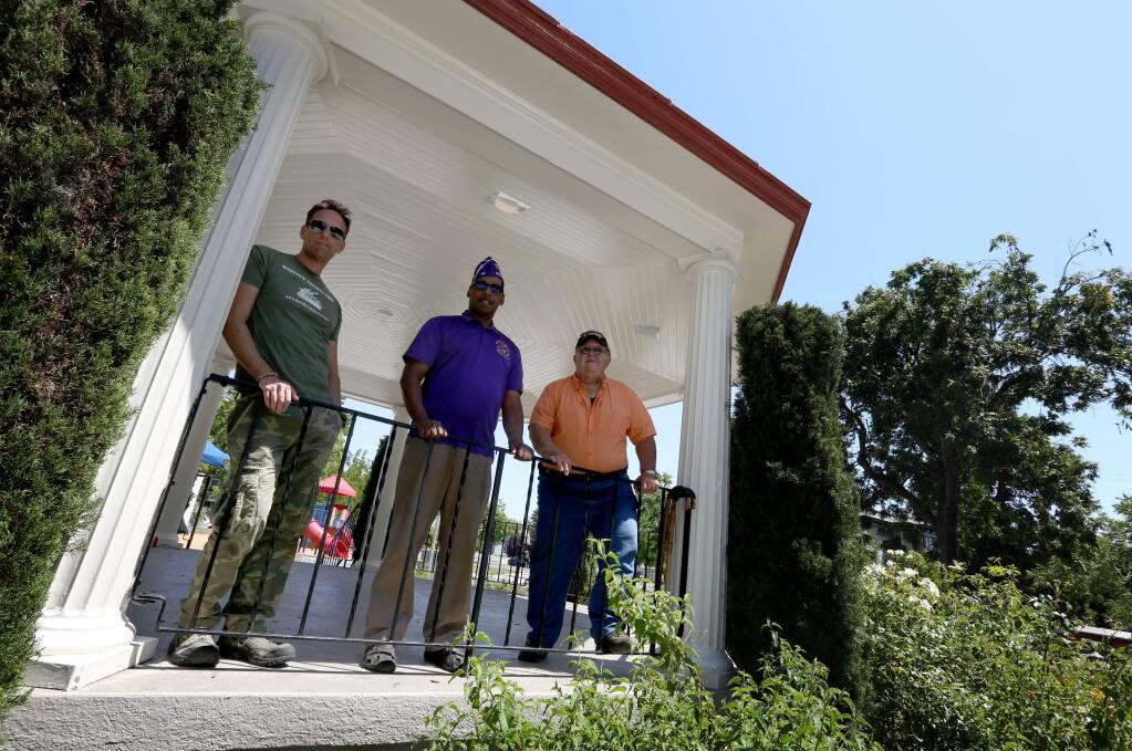 Joe Noriel, left, Charles Earthman, center and Paul Lewis, right, stand near where they hope to install a Korean War Veterans Memorial monument in Petaluma's Walnut Park, Thursday, June 25, 2015. (CRISTA JEREMIASON / The Press Democrat)