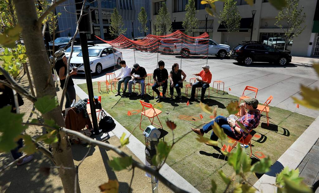 Two parking spots were used to set up a Parklet along the west side of Old Courthouse Square in Santa Rosa, Friday Sept. 15, 2017. (Kent Porter / The Press Democrat) 2017