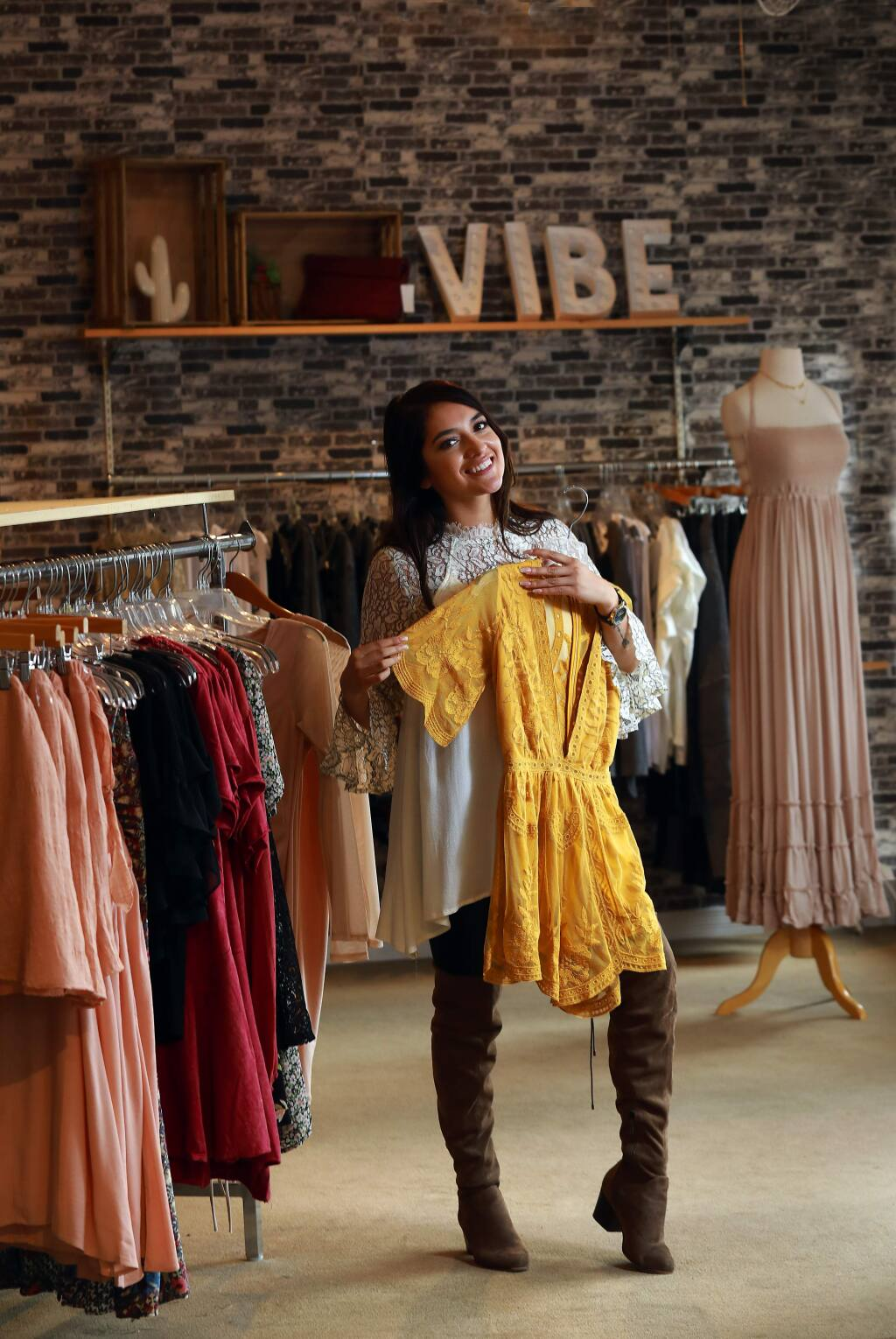 Latina entrepreneur and self-described fashionista Mercedes Hernandez, 22, opened Bow N Arrow Clothing in downtown Cotati last year. (John Burgess/The Press Democrat)