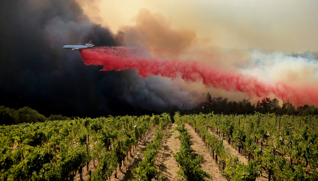 A DC-10 air tanker drops suppressant on the left flank of the Glass Fire along Crystal Springs Road, running towards Silverado Trail on Sunday, Sept. 27, 2020. (Kent Porter / The Press Democrat) 2020