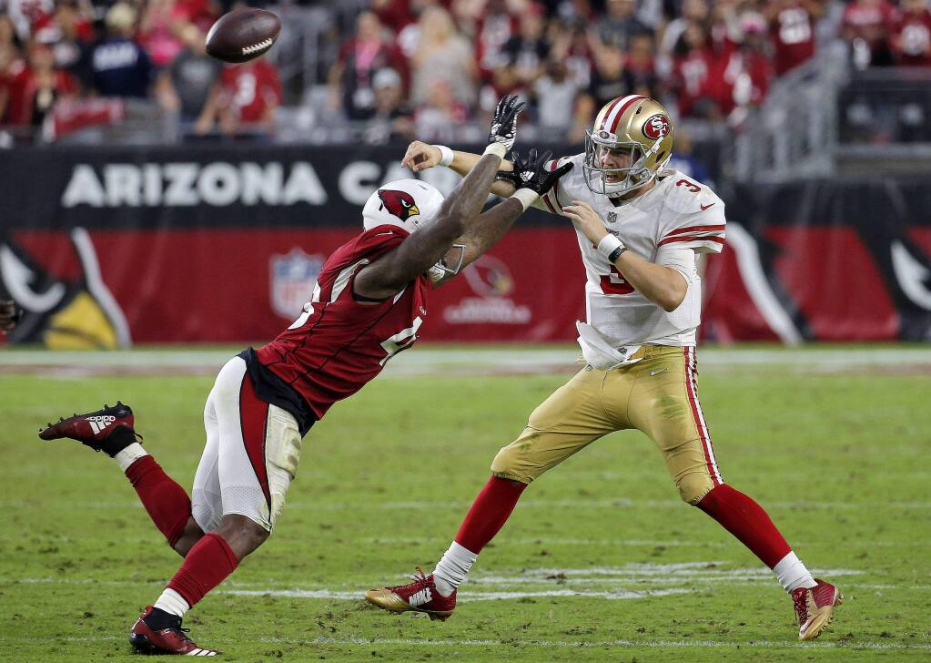 San Francisco 49ers quarterback C.J. Beathard throws under pressure from Arizona Cardinals linebacker Haason Reddick during the second half, Sunday, Oct. 28, 2018, in Glendale, Ariz. The Cardinals won 18-15. (AP Photo/Rick Scuteri)
