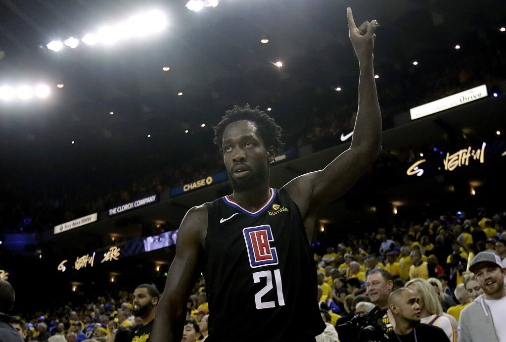 FILE - In this April 15, 2019, file photo, Los Angeles Clippers guard Patrick Beverley celebrates during the second half of Game 2 of a first-round NBA basketball playoff series against the Golden State Warriors in Oakland, Calif. No more watching other teams go deep in the playoffs. The NBA's balance of power has shifted to the Clippers, who have never advanced beyond the second round let alone won a championship. The Clippers are favorites to win it all, a stunning shift for a franchise that has spent much of its existence as a punch line. (AP Photo/Jeff Chiu, File)