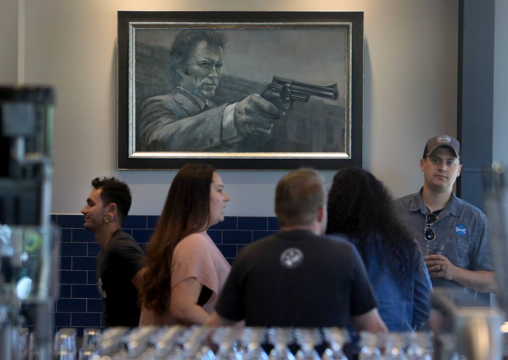 A portrait of Clint Eastwood's character Dirty Harry was painted by a friend of Seismic Brewing Co. owner Christopher Jackson, as part of homage to the Jackson family roots in San Francisco law enforcement. The brewery takes part in SF Beer Week. (Kent Porter / The Press Democrat)