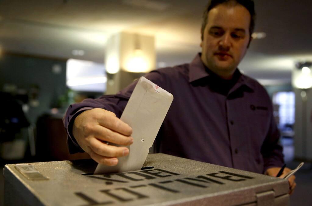 Dylan Lloyd casts his ballot at the Petaluma Community Center in Petaluma, California on Tuesday, November 4, 2014. (BETH SCHLANKER/ The Press Democrat)