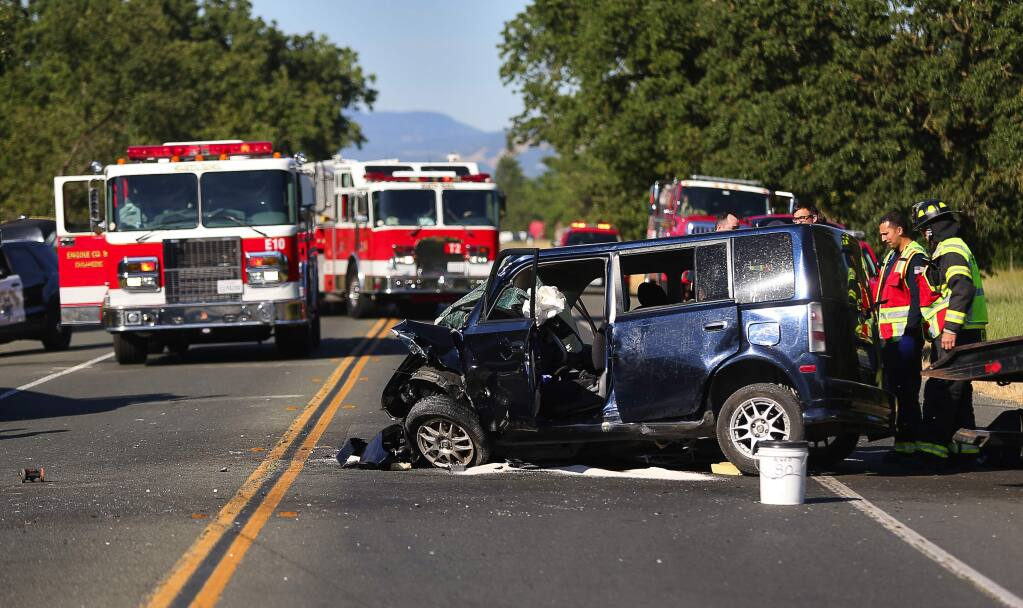 A head-on collision involving two vehicles at Highway 12 and Merced Avenue closed down part of Highway 12 in Santa Rosa on Monday, May 22, 2017. (CHRISTOPHER CHUNG/ PD)