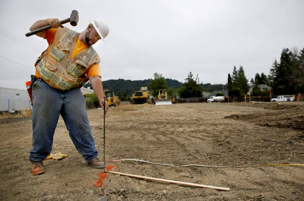 Mike Gayski, a grading foreman with Northwest General Engineering, drives in stakes to set the grade as construction gets underway on a 30-unit apartment complex for low income farmworkers. Photo taken in Santa Rosa, on Tuesday, June 7, 2016. (BETH SCHLANKER/ The Press Democrat)