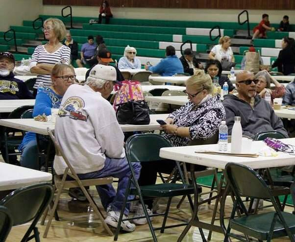 Sonoma residents wait out the Oct. 9 fire crisis in the gymnasium at Sonoma Valley High School. (Bill Hoban/Index-Tribune)