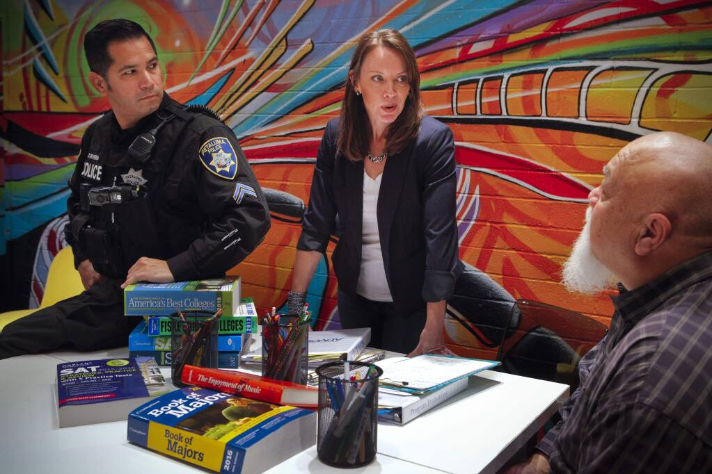 Petaluma, CA, USA. Thursday, January 18, 2018._ Deborah Dalton, Executive Director at Mentor Me works closely with police officer, Zilverio (Zeus) Rivera in a new restorative justice program for teens. Dolan Beaird (far right), the advocacy team caseworker also assists in the program. (CRISSY PASCUAL/ARGUS-COURIER STAFF)