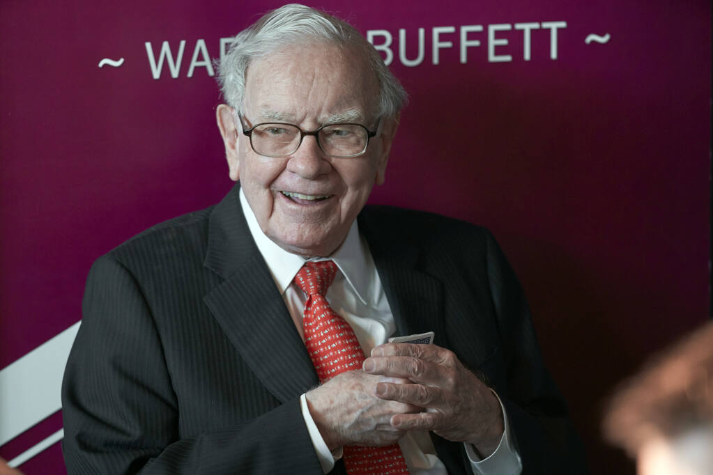 Warren Buffett, Chairman and CEO of Berkshire Hathaway, smiles as he plays bridge following the annual Berkshire Hathaway shareholders meeting in Omaha, Neb., Sunday, May 5, 2019. (AP Photo/Nati Harnik)