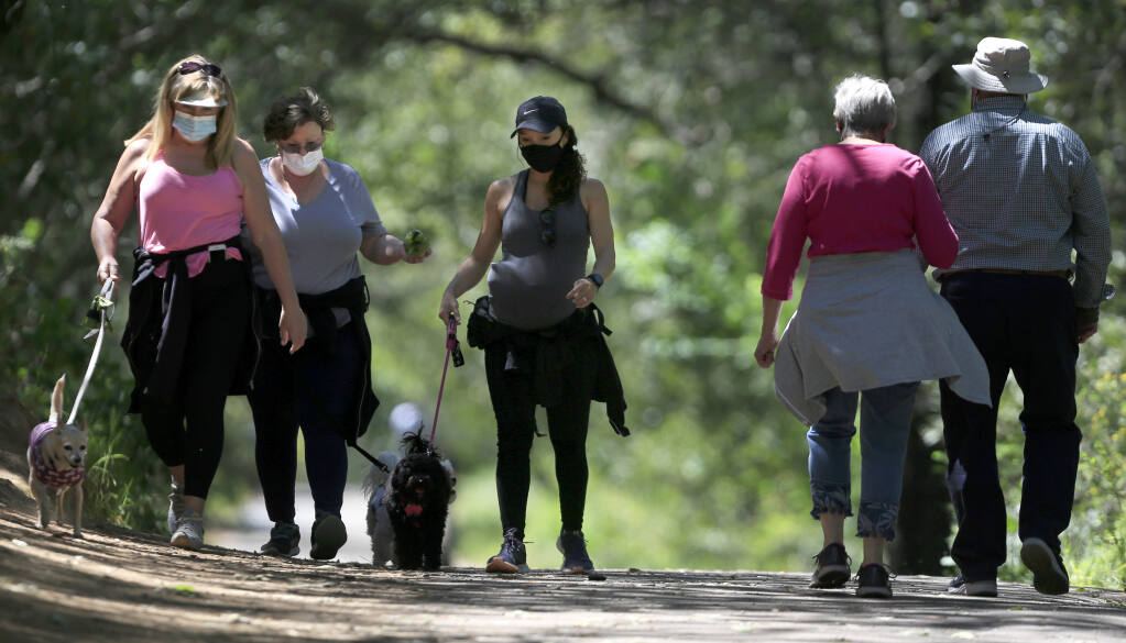 From left, Susan Saludes, Suzanne Alverio and Bernadette Alverio take advantage of the warm spring day for exercise at Howarth Park in Santa Rosa, Tuesday, April 27, 2021. (Kent Porter / The Press Democrat) 2021
