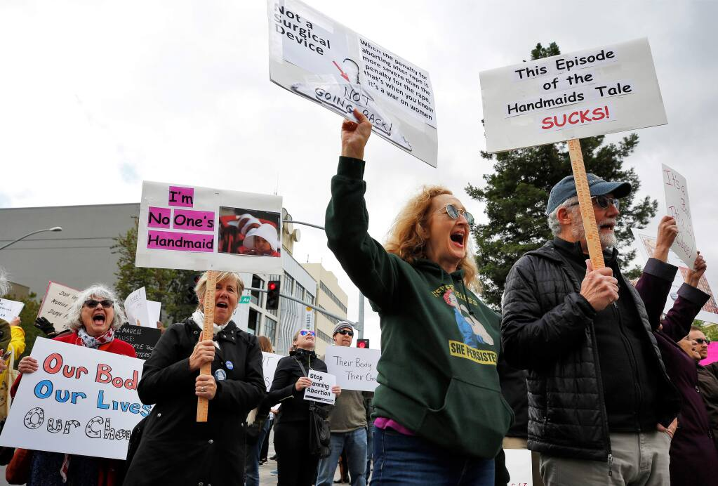 From far right: Phil and Ruth Hansten, Pat Bakalian, and Becky Montgomery chant with other demonstrators during the Stop the Ban rally held in protest to anti-abortion laws being passed in other states, at Old Courthouse Square in Santa Rosa, California, on Tuesday, May 21, 2019. (Alvin Jornada / The Press Democrat)