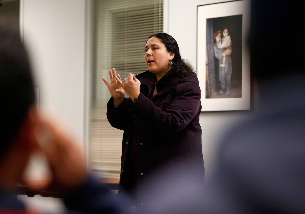 Catholic Charities' Board of Immigration Appeals (BIA) accredited immigration representative Marcela Morales gives a seminar to a group of undocumented Sonoma County residents about their civil rights and facing the possibility of deportation, at Catholic Charities in Santa Rosa, California on Wednesday, February 22, 2017. (Alvin Jornada / The Press Democrat)