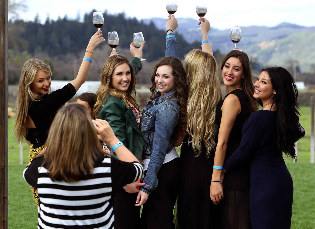 College friends from SSU and SRJC pose for a picture at Truett Hurst in the Dry Creek Valley during Wine Road Barrel Tasting in March. (John Burgess / PD file 2014)