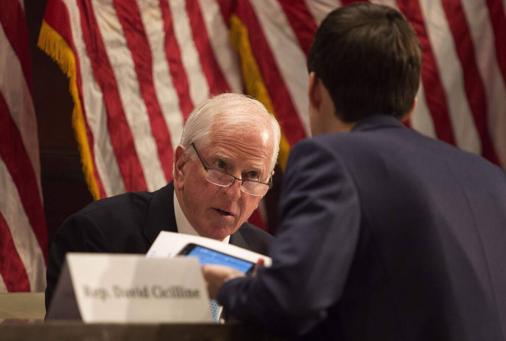 UNITED STATES - DECEMBER 8 - Rep. Mike Thompson, D-Calif., speaks to a hill staffer before a forum on common sense solutions to address gun violence on Capitol Hill in Washington, Tuesday, December 8, 2015. (Photo By Al Drago/CQ Roll Call) (CQ Roll Call via AP Images)