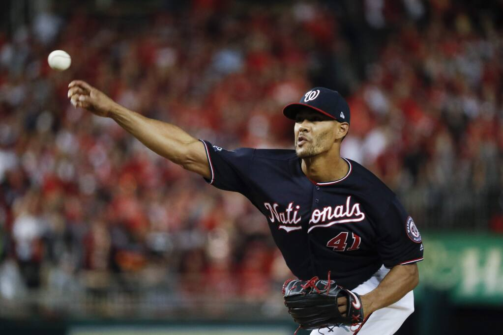 Washington Nationals pitcher Joe Ross throws against the Houston Astros during the first inning of Game 5 of the baseball World Series Sunday, Oct. 27, 2019, in Washington. (AP Photo/Jeff Roberson)