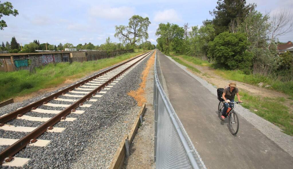 A newly installed bike path between Sebastopol Road and Hearn Ave. in Santa Rosa, runs alongside of the SMART tracks, Friday April 8, 2016. (Kent Porter / Press Democrat) 2016