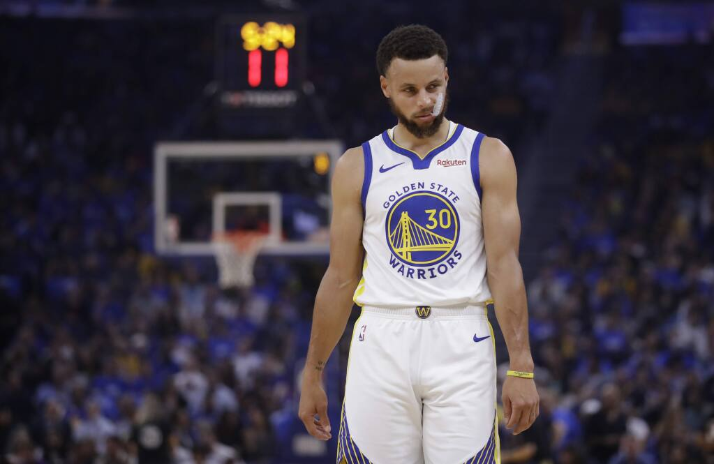 The Golden State Warriors' Stephen Curry walks on the court during the first half against the Los Angeles Clippers on Thursday, Oct. 24, 2019, in San Francisco. (AP Photo/Ben Margot)