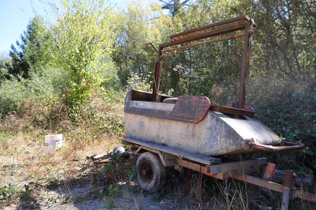 An old rollercoaster car that was turned into a barbecue sits at the former J's Amusements Park site in Guerneville on Monday, September 23, 2019. (Christopher Chung/ The Press Democrat)
