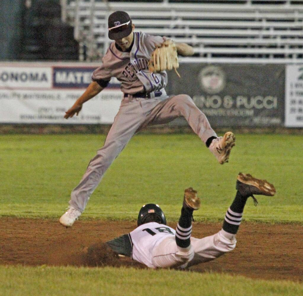 Bill Hoban/Index-TribuneSonoma's Jeremy Mackling forces the Petaluma shortstop to go airborne during a slide into second in Friday night's game.