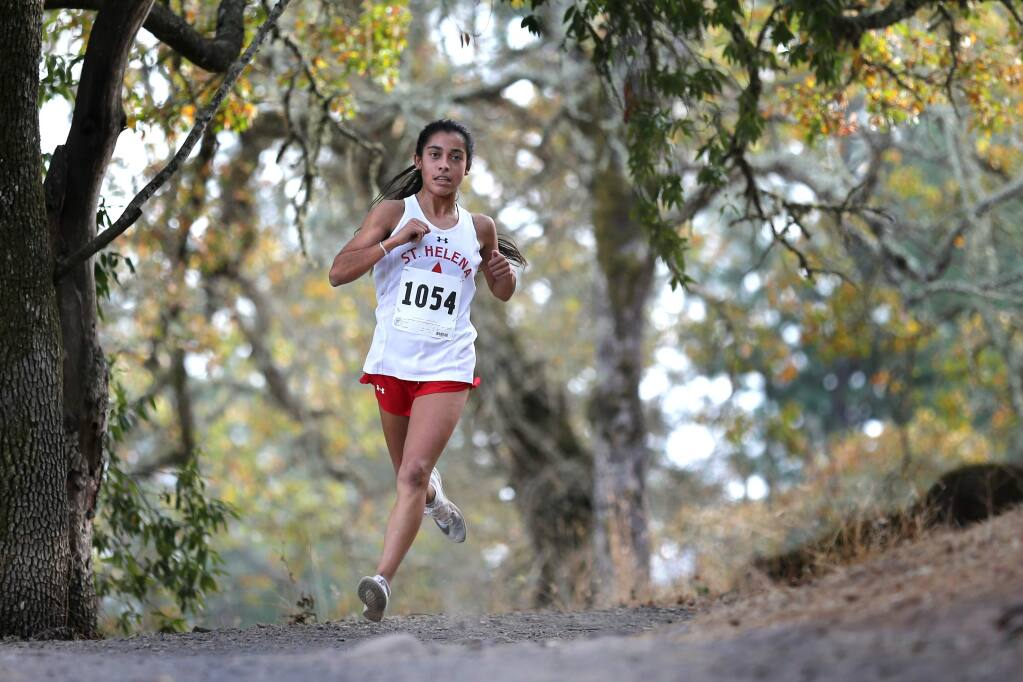 St. Helena junior Harper McClain runs during the Coastal Mountain Conference finals at Spring Lake Regional Park in Santa Rosa on Wednesday, Nov. 13, 2019. (BETH SCHLANKER / The Press Democrat)