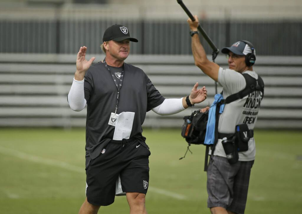 Oakland Raiders head coach Jon Gruden during training camp Monday, July 29, 2019, in Napa. (AP Photo/Eric Risberg)