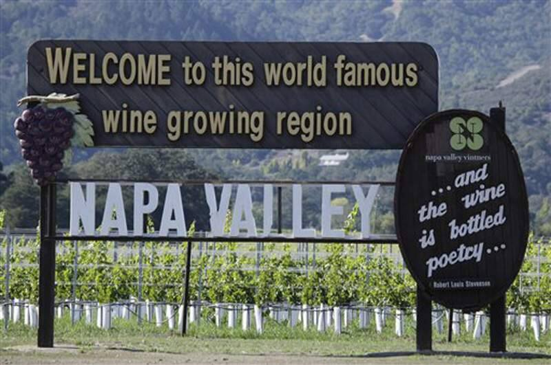 In this photo taken Oct. 27, 2011, a sign along Highway 29 welcomes visitors to the Napa Valley in Oakville, Calif. (AP Photo/Eric Risberg)