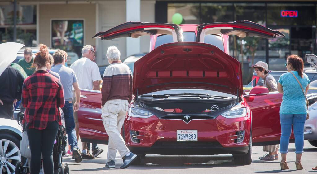 Guests check out a Tesla Model X during an event promoting electric vehicles at Coddingtown Mall in Santa Rosa, Sunday, Sept. 11, 2016. (Jeremy Portje / For The Press Democrat)