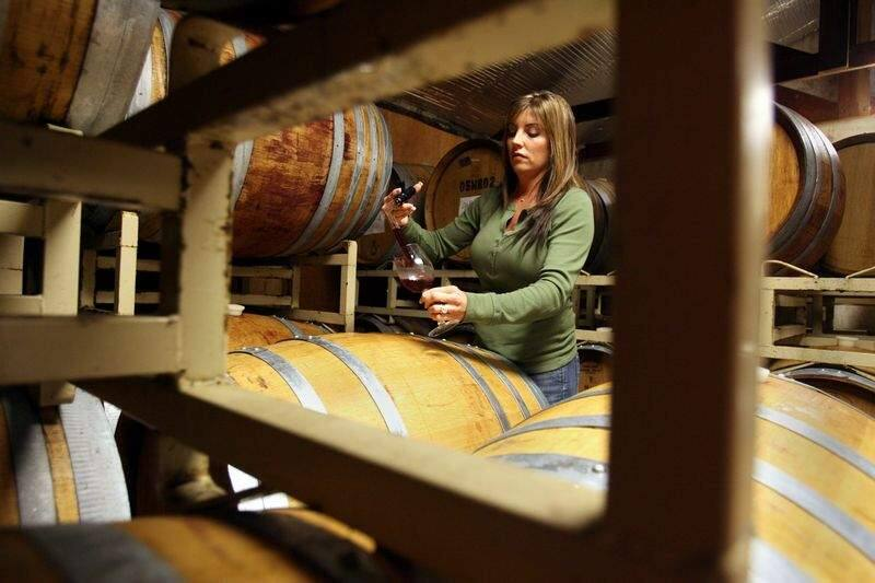 Tracy Dutton, owner of Dutton Estate Winery uses a wine thief to check on a barrel of 2006 Pinot Noir wine from Manzana vineyard in the barrel room of her Green Valley Road winery near Graton, CA on Friday February 9, 2007. Scott Manchester / The Press Democrat