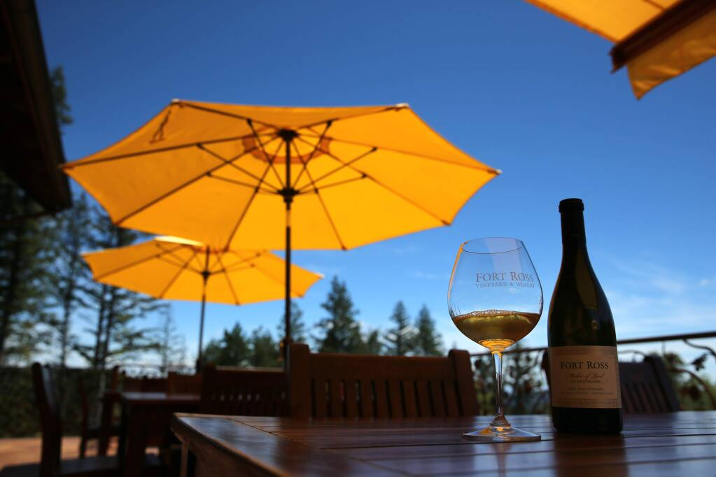 A glass and bottle of Chardonnay on the patio at Fort Ross Vineyard & Winery in Fort Ross on Wednesday, May 22, 2019. (BETH SCHLANKER/ The Press Democrat)