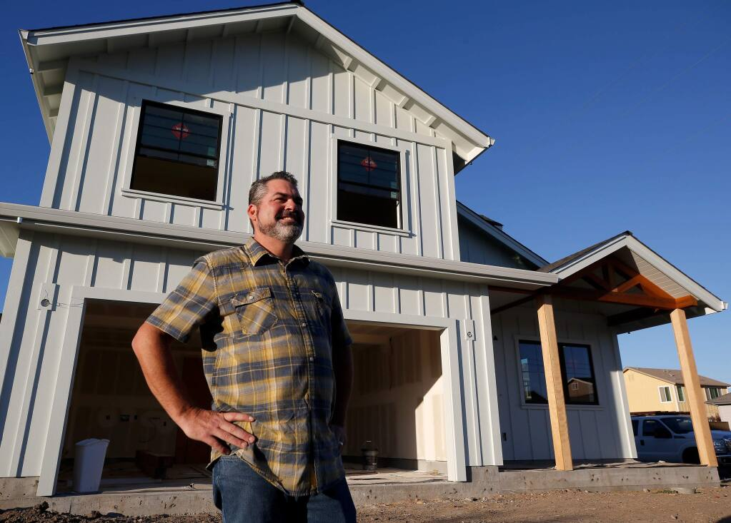 Steve Rahm, Tubbs fire survivor and incoming president of Coffey Strong, stands in front of his nearly rebuilt home in the Coffey Park neighborhood of Santa Rosa, California, on Tuesday, Oct. 22, 2019. (Alvin Jornada / The Press Democrat)