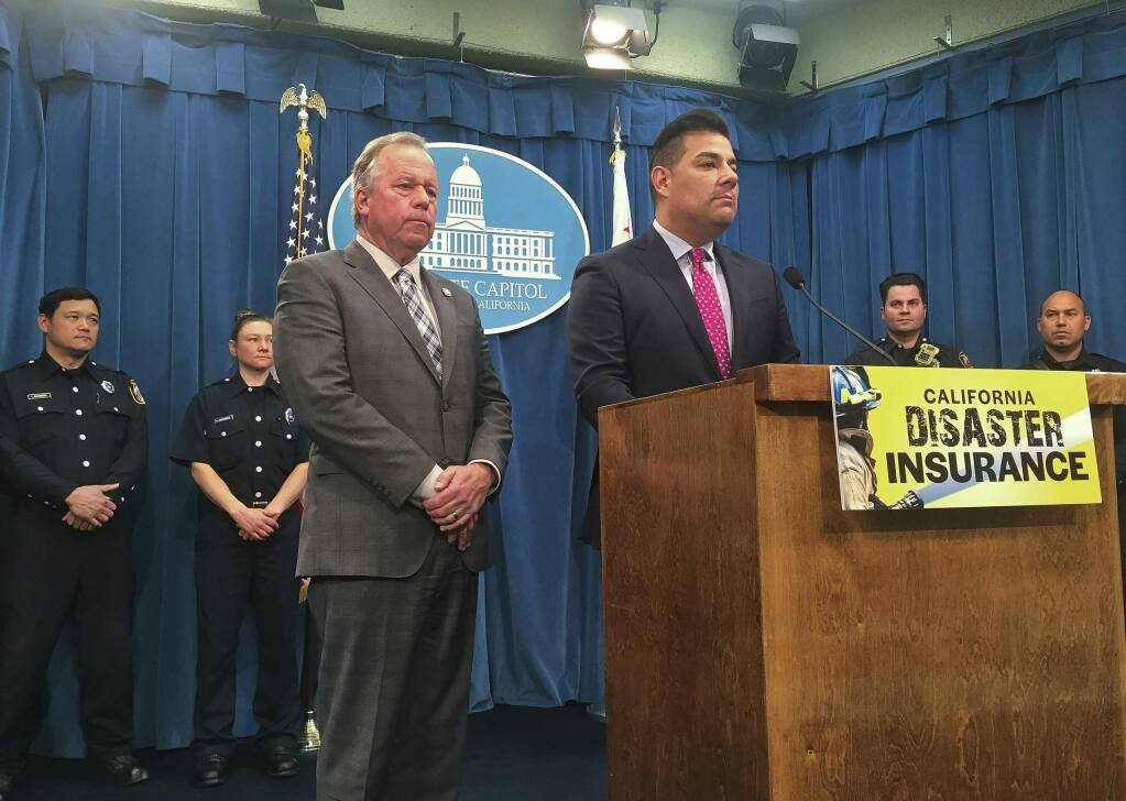 State Sen. Bill Dodd, D-Napa, and Insurance Commission Ricardo Lara?announce legislation at a Feb. 14 news conference that would allow the state to purchase insurance for fires and other disasters. (DON THOMPSON / Associated Press)