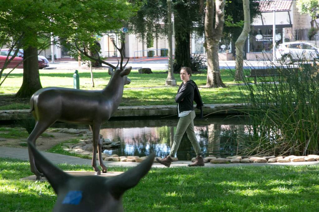 Curator Tanya Gayer checks the placement of six large deer statues, by artist Gwynn Murrill, in the southwest corner of the Sonoma Plaza, part of a public art installation by the Sonoma Valley Museum of Art, Tuesday, June 5, 2018. (Photo by Julie Vader/special to the Index-Tribune)