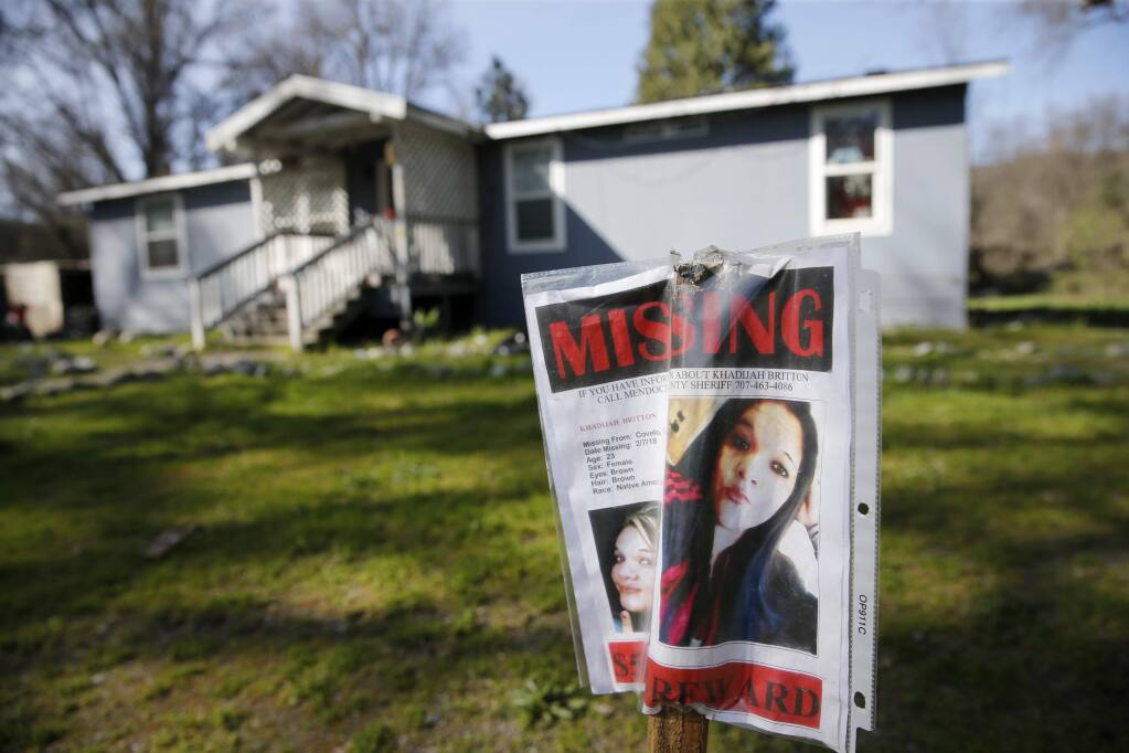 A missing sign for Khadijah Britton, 23, is displayed outside her family home on Tuesday, March 27, 2018, in Covelo, California. (BETH SCHLANKER / The Press Democrat)