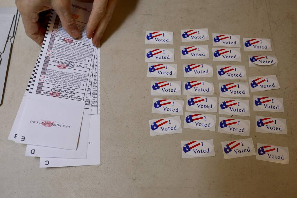 'I voted' stickers sit on the table next to the ballot box in Anderson Hall on Tuesday, June 5, 2018 in Camp Meeker, California . (BETH SCHLANKER/The Press Democrat)