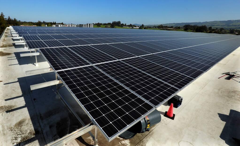 Rohnert Park's Westcoast Solar Energy company is installing a 2.15 megawatt system at Lagunitas Brewing in Petaluma . (John Burgess/The Press Democrat)