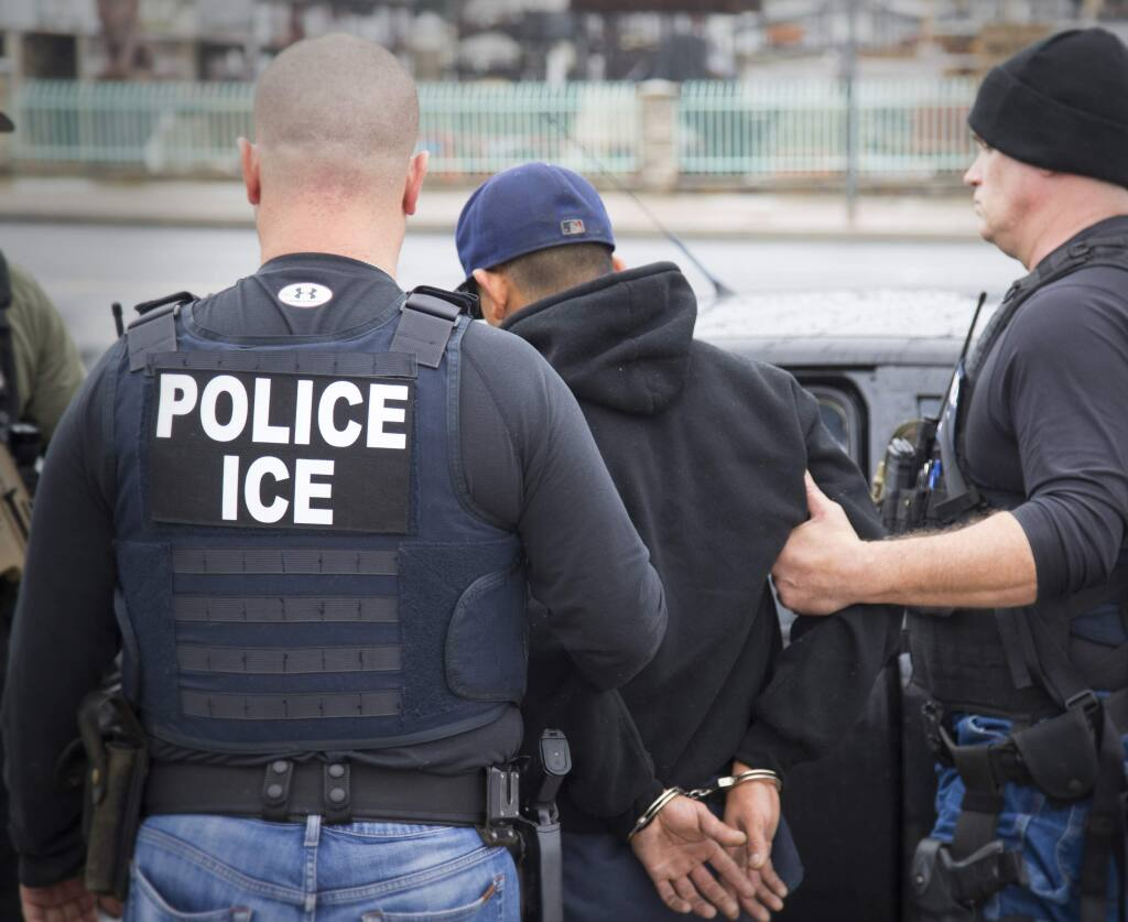 In this Tuesday, Feb. 7, 2017, photo released by U.S. Immigration and Customs Enforcement shows foreign nationals being arrested during a targeted enforcement operation conducted by U.S. Immigration and Customs Enforcement (ICE) aimed at immigration fugitives, re-entrants and at-large criminal aliens in Los Angeles. (Charles Reed/U.S. Immigration and Customs Enforcement via AP)