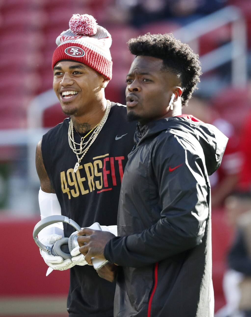 San Francisco 49ers wide receiver Kendrick Bourne, left, talks with wide receiver Marquise Goodwin before an NFL football game against the Chicago Bears in Santa Clara, Calif., Sunday, Dec. 23, 2018. (AP Photo/Tony Avelar)